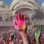 Revellers with coloured corn starched hands celebrate during the 2014 Festival of Colours, Holi Celebration at the Krishna Temple in Spanish Fork, Utah.<span class=