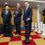 Enda Kenny plays some giant chess. <span class=