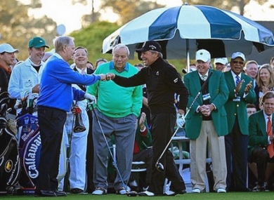 Jack Nicklaus and Gary Player locks fists with Arnold Palmer watching on.