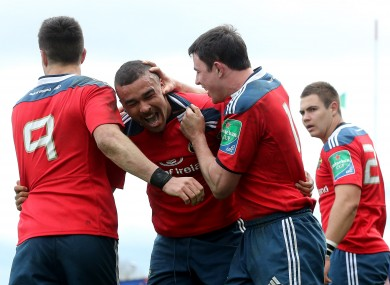 Munster players Felix Jones and Simon Zebo celebrate a try against Toulouse.
