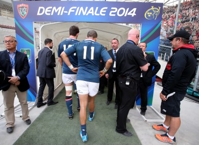 Sion Zebo trudges down the tunnel after Munster's defeat.