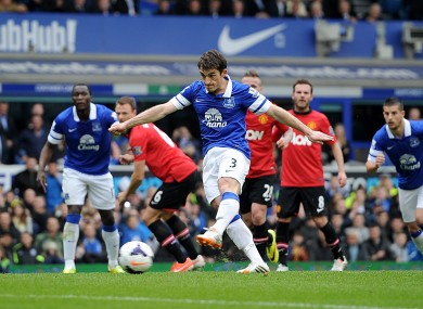 Leighton Baines scores from the penalty spot.
