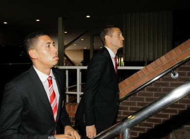 Smalling and Vidic arrive for a game recently.