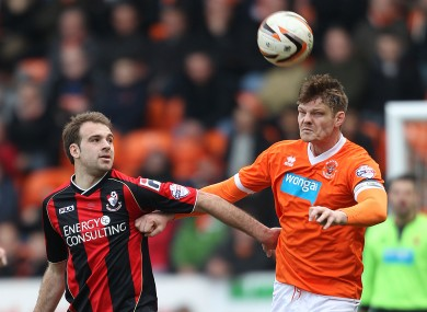 Pittman, left (pictured here against Blackpool), cleared off the line for Bournemouth.
