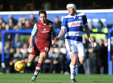 Richard Dunne and Burnley's Danny Ings compete for possession.