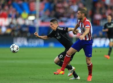 Atletico Madrid's Mario Suarez (right) and Chelsea's Fernando Torres.