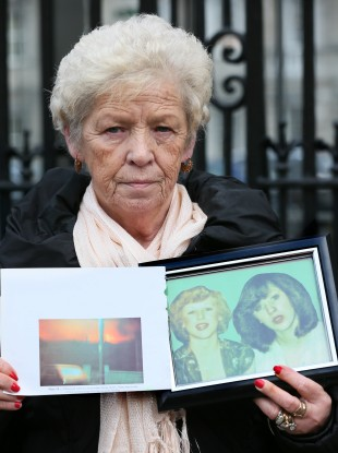 Christine Keegan holds a picture of the daughters she lost in the Stardust fire.