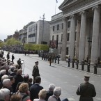 President Michael D Higgins, stands to attention as the 1916 Proclamation is read<span class=