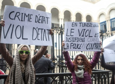 Tunisian women demonstrate outside a Tunis courthouse