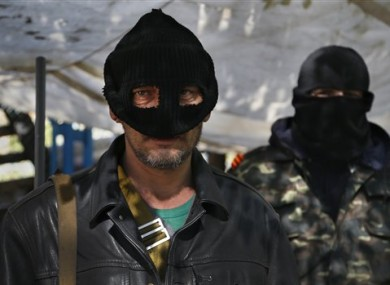 Masked pro Russian militants stand guard at the barricades in Slovyansk , eastern Ukraine.