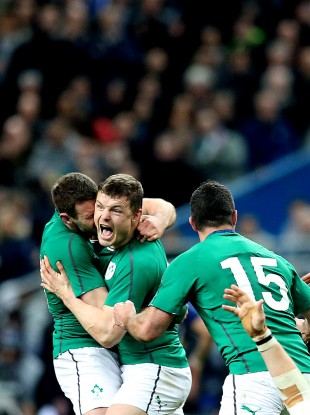 Brian O'Driscoll celebrates Ireland's Six Nations win in Paris.