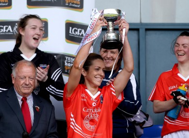 Caitlin Malone lifts the trophy for Armagh.