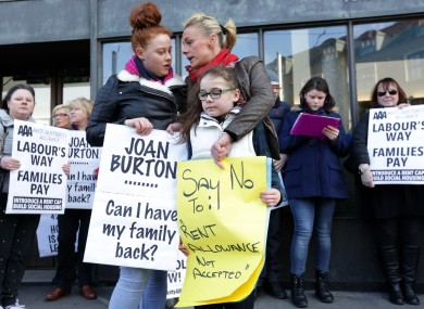 FILE:  Gwen Connell with two of her three daughters Lauren (left, 17) and Katie (10) protest along with members of the Anti Austerity Alliance outside the Department of Social Protection
