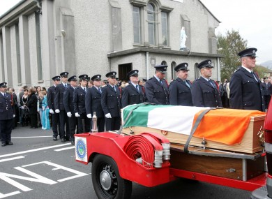 The remains of part-time firefighter Mark O'Shaughnessy are taken from the Church of Our Lady Queen of Peace in Bray.