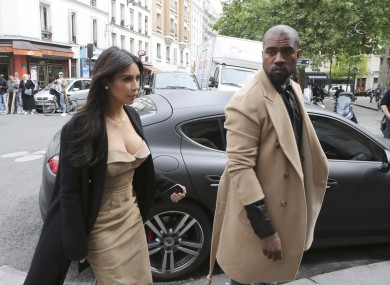 Kim Kardashian and Kanye West arrive at a luxury shop in Paris last week.