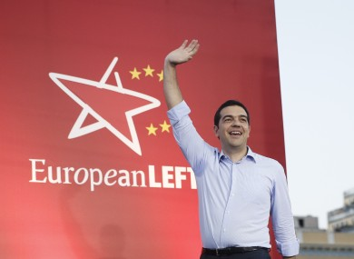Greece's left-wing opposition leader Alexis Tsipras greets supporters at his party's main election rally earlier this week.