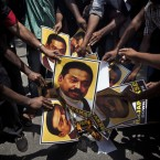 Supporters of Marumalarchi Dravida Munnetra Kazhagam (MDMK) burn portraits of Sri Lankan President Mahinda Rajapaksa during a protest in New Delhi.<span class=