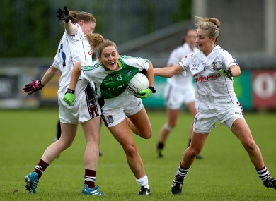 Mairead Coyne and Sinead Burke with Fiona Leavy battle for possession.
