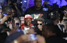 Justin Bieber accompanies 'Money' Mayweather to ring before he goes 46-0