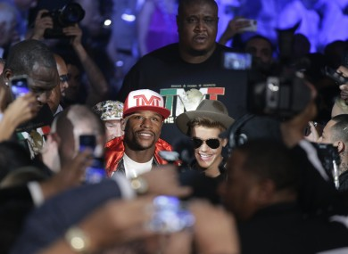 Floyd Mayweather Jr., right, connects with a right to the head of Marcos Maidana.