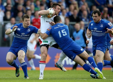 Rob Kearney halts the run of Ulster's Tommy Bowe.