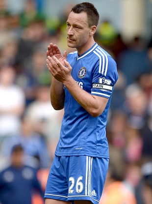 Chelsea captain applauds fans at full time.