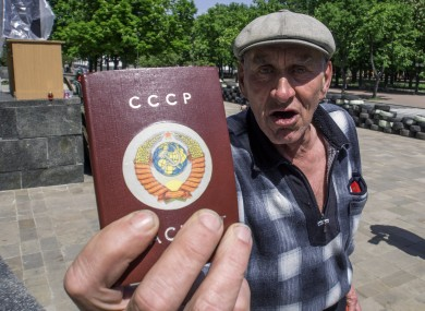 An elderly man brandishes his passport, ahead of the regional referendum in the eastern Ukraine city of Luhansk.