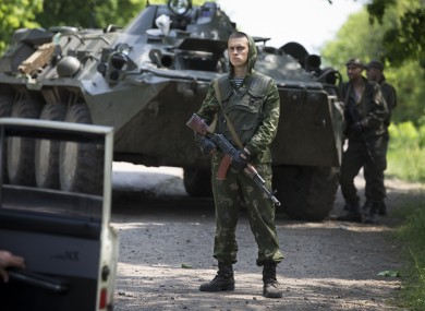 Ukrainian government soldiers guard a checkpoint near Kramatorsk, eastern Ukraine.