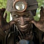 A Ukrainian coal miner smiles, after finishing his shift at a coal mine outside Donetsk.<span class=