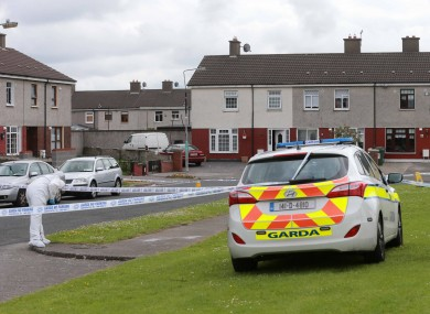 Gardaí carry out investigations at the scene of the shooting.