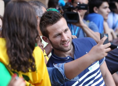 France's Yohan Cabaye poses with fans ahead of a press conference at the Teatro Pedro II in Ribeirao Preto, Brazil.
