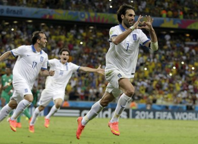 Greece's Giorgos Samaras celebrates scoring his side's second goal from the penalty spot.