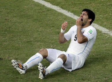 Toothache: Suarez reacts to that clash with Chiellini.
