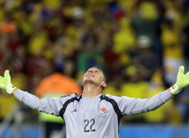 Faryd Mondragon celebrates after Colombia's James Rodriguez scored his side's fourth goal.