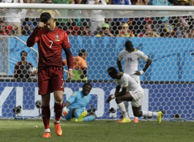Cristiano Ronaldo ambles back to the halfway line after scoring Portugal's second goal.