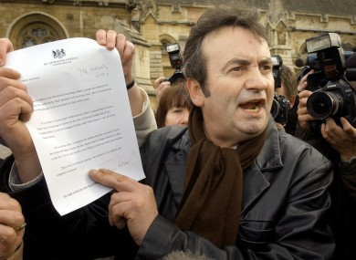 Gerry Conlon outside the House of Commons with the letter of apology he received from Prime Minister Tony Blair in 2005.