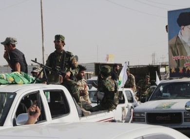 Iraqi Shiite fighters deploy with their weapons in Basra, Iraq's second-largest city, 340 miles (550 kilometers) southeast of Baghdad.
