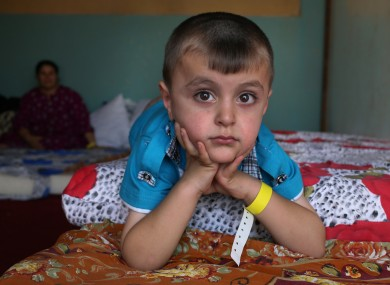 An Iraqi Christian displaced boy who fled from the Christian village of Hamdania