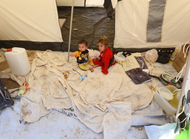 Iraqi children who have fled fighting between security forces and al-Qaida inspired militants in their hometown of Tal Afar carry sit in a tent at Germawa camp for displaced Iraqis.