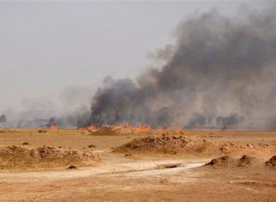 Smoke rises during a military operation to regain control of Dallah Abbas north of Baqouba, the capital of Iraq's Diyala province.