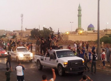 Rebels parade in the northern city of Mosul.