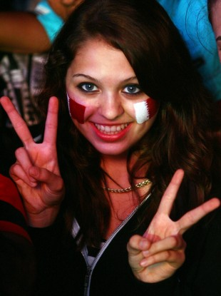 A woman celebrates the awarding of the 2022 World Cup to Qatar in 2010.