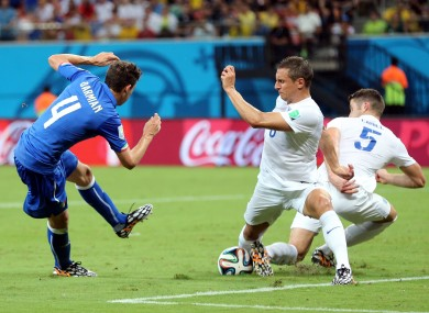 Italy's Matteo Darmian has his shot blocked by England's Gary Cahill (right) and Phil Jagielka.