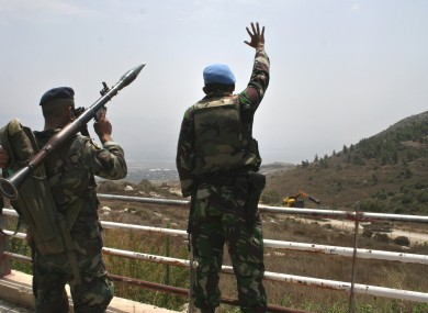 A UNIFIL peacekeeper (r) with a Lebanese soldier holding an RPG at a southern border village in Lebanon