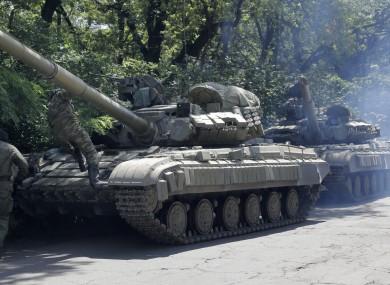 Pro-russian troops prepare to travel in a tank on a road near the town of Yanakiyevo, Donetsk region, eastern Ukraine.