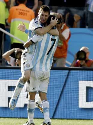 Argentina's Messi and Di Maria celebrate their late escape.