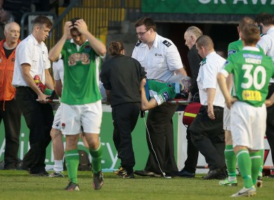 Cork City's Brian Lenihan is taken off injured after a bad fall at Dalymount Park.