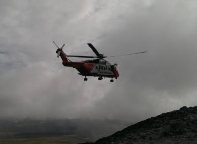 The Coast Guard helicopter leaving the mountain yesterday
