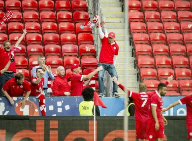 Danny North celebrates scoring Sligo Rovers' second goal with fans.