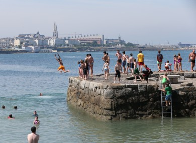 Swimmers at Sandycove, Dublin yesterday.